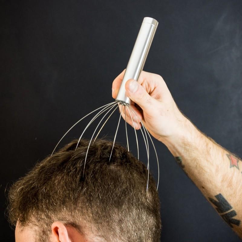 Massaggia testa con vibrazione