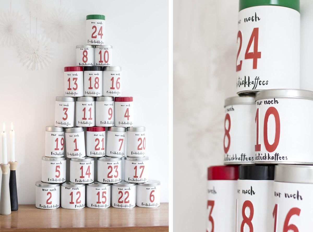 Calendario dell'avvento con barattoli di caffè